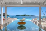 VILLA MAPAI... Stunning contemporary oceanfront home, heated pool, full AC, kayak to Pinel Island!